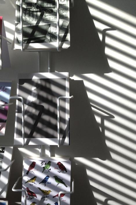Shadows on postcard rack